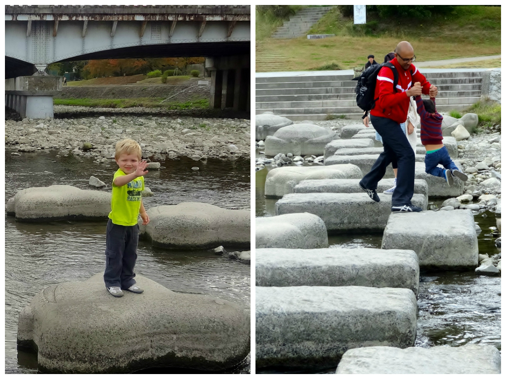 Kids enjoying stepping stone river crossing in Kyoto