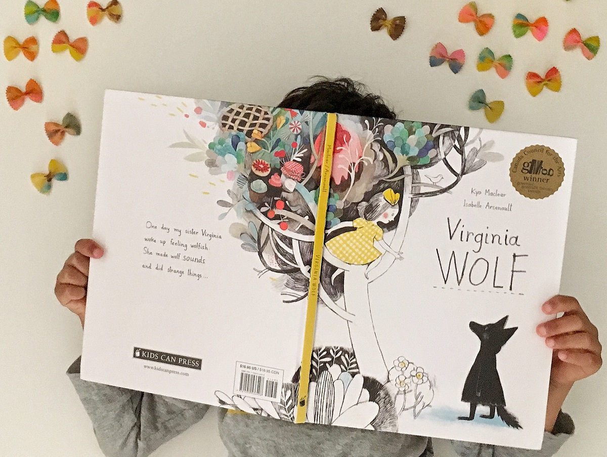 Reading Virginia Wolf by Kyo Maclear and Isablle Arsenault surrounded by butterflies