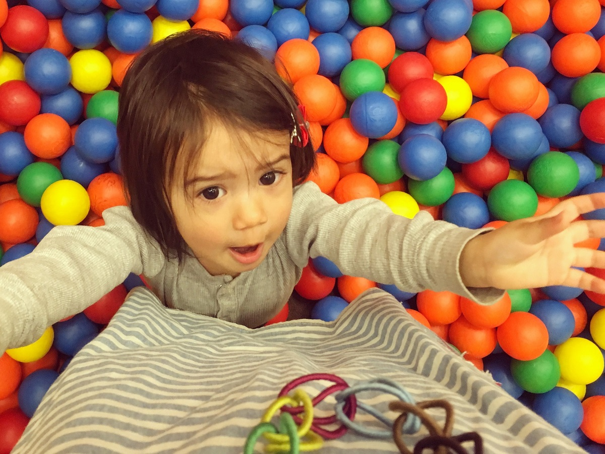 Playing in a ball pit at a Detsky Koutek in Prague